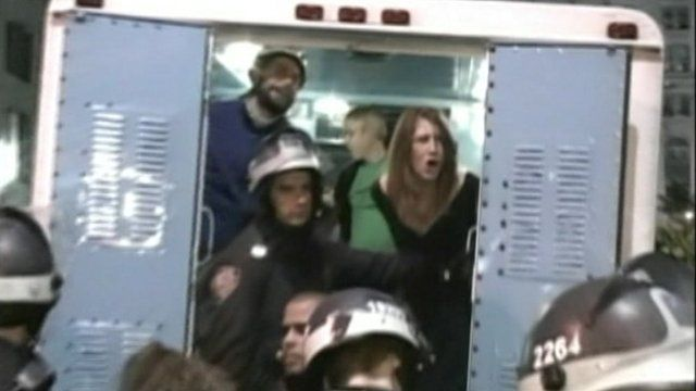 Woman shouting from a police van