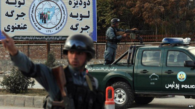 Afghan policemen stand guard in Kabul