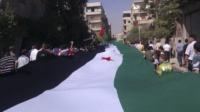 Demonstrators protesting against Syria's President al-Assad