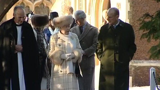 The Queen walks with the Duke of Edinburgh
