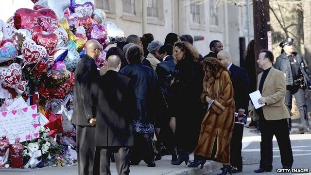 Guests arrive for the funeral service