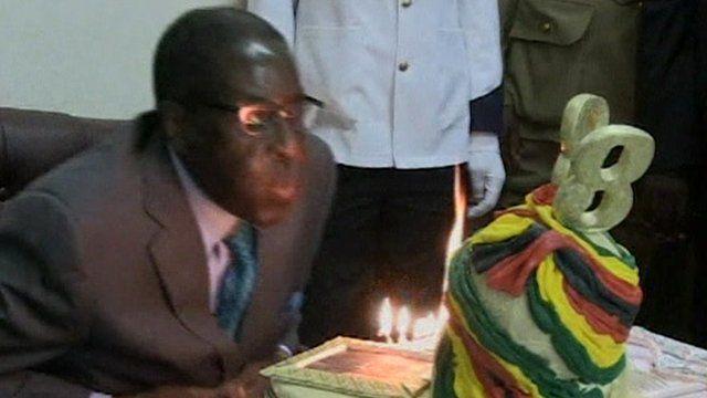 President Robert Mugabe blows out birthday candles