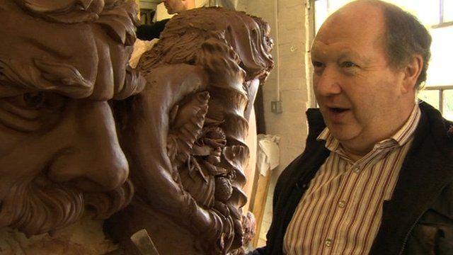 Alan Lamb next to one of his sculptures
