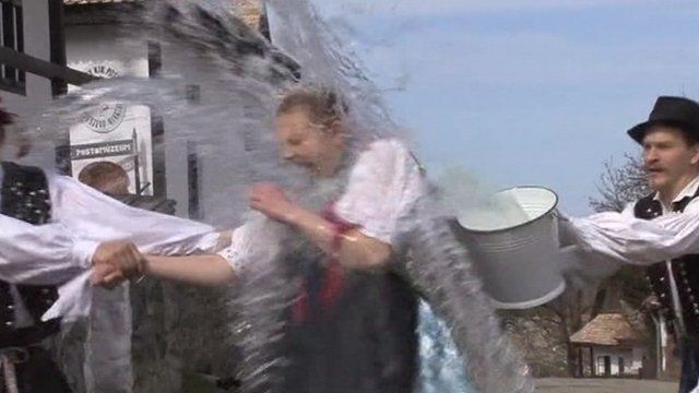 Men pour water on women in Hungary in an Easter ceremony