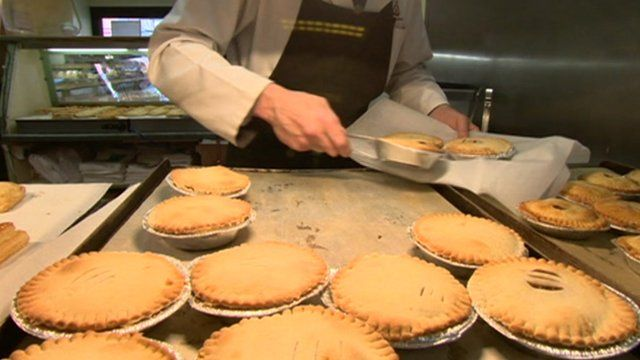 Hot pies being put on display