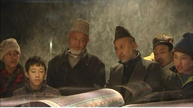 Afghans looking at the country's new copy of the Koran.