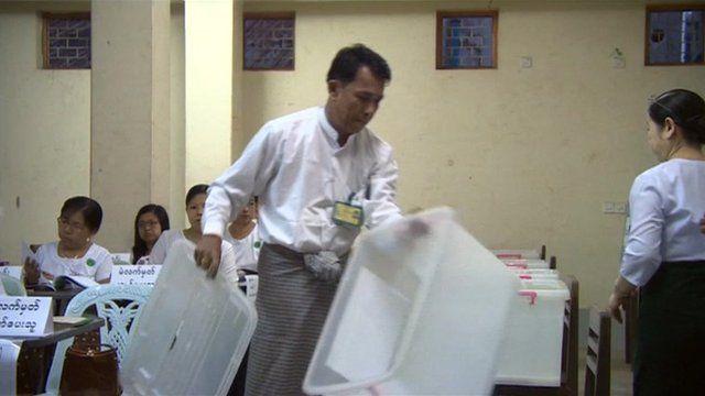 A man with a ballot box in Burma