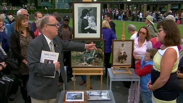 Clive Danahar looking at Diana prints on the Antiques Roadshow