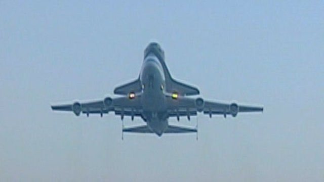 The shuttle Discovery bolted on top of a jumbo jet