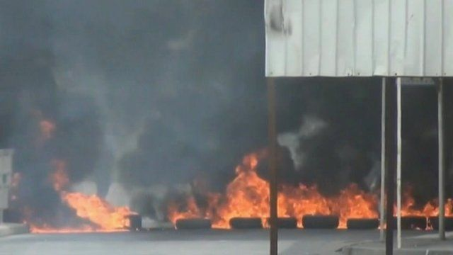 Tyres on fire in the streets of Manama