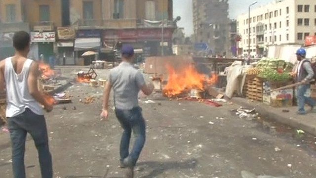 Debris and a fire after clashes in Cairo