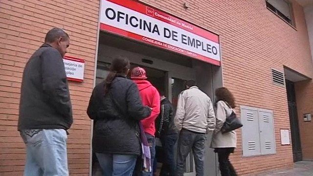 People entering a job centre in Madrid