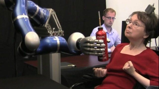Cathy Hutchinson using a robot arm to take a sip of coffee - Courtesy Brown University
