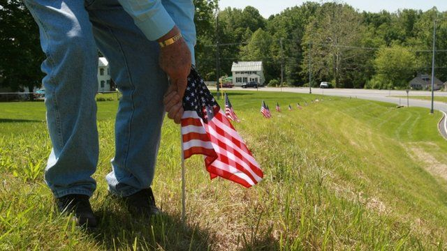 Jim Stull, 78, a life long resident of Thurmont, Md, places American flags along the exit ramp from Route 15 to Route 77