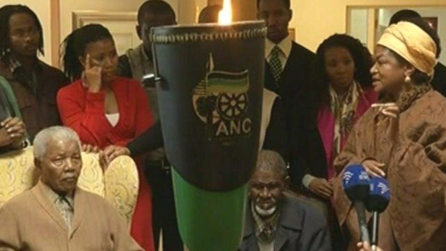 Nelson Mandela (left) with ANC flame in foreground