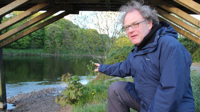 Aidan Turner-Bishop points to the spot on the River Ribble where the first Mormon baptisms in England took place
