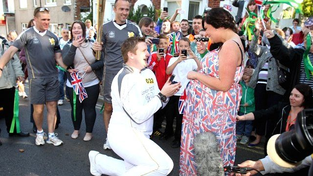 Torchbearer, David State, proposes to his girlfriend
