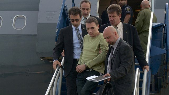 Luka Magnotta is escorted off a plane