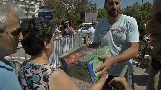 Greek woman receives free vegetable package