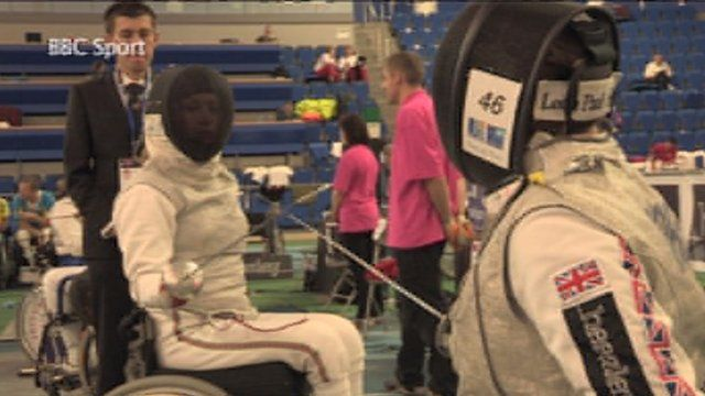 Two wheelchair fencers in action
