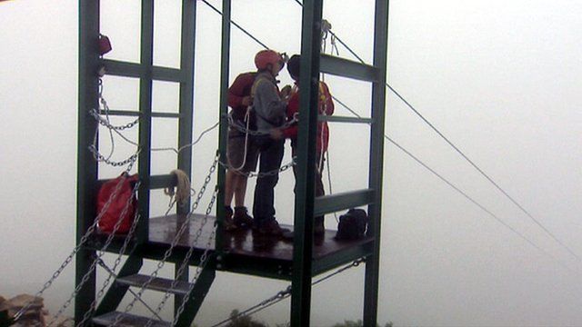 Man prepares to go on a zip wire slide