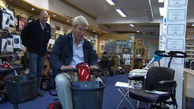 Jeremy Paxman on mobility scooter
