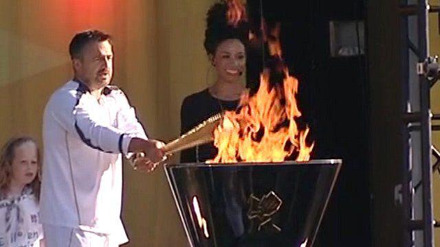 John Bowman lighting Chelmsford's Olympic cauldron
