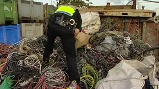 Police officer looks at scrap metal