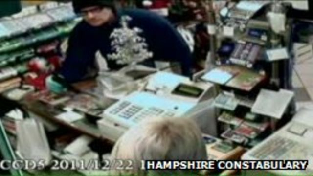 Parcell was caught on CCTV brandishing an imitation handgun