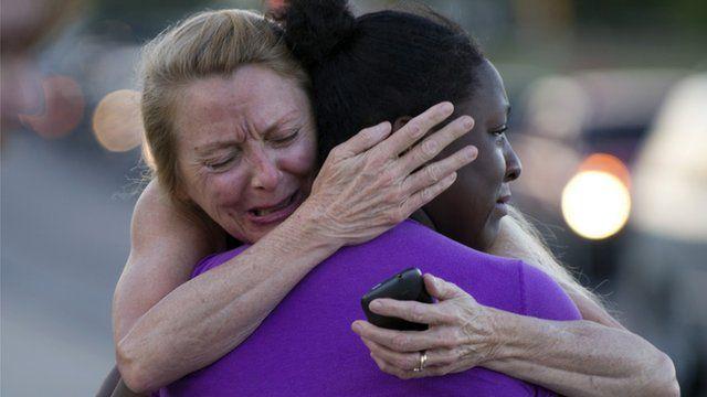 Mourners embrace in Aurora, Colorado
