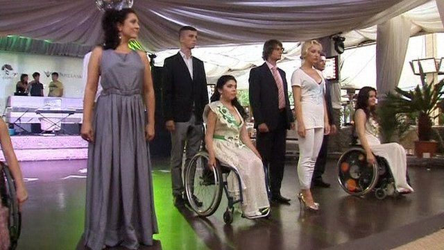 Disabled models on a podium