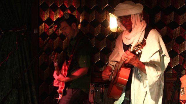 Abdallah Oumbadougou (right) playing at Momo's, London