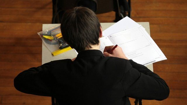 A pupil sitting a maths exam