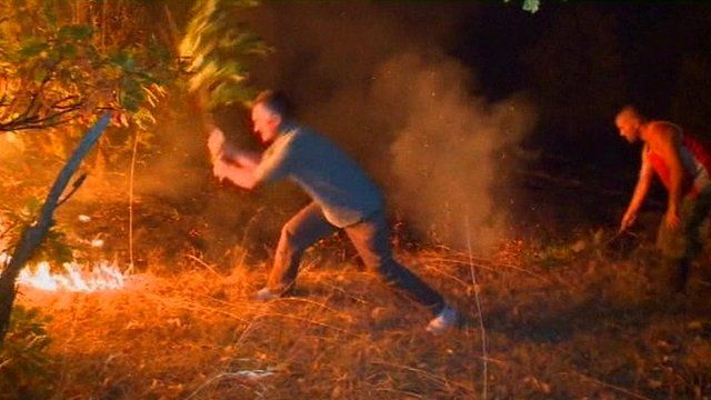 Man trying to put out fire