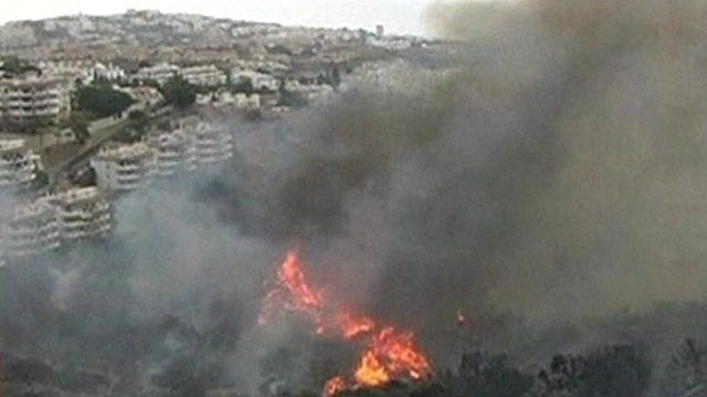 Fire and smoke spreading towards apartment blocks