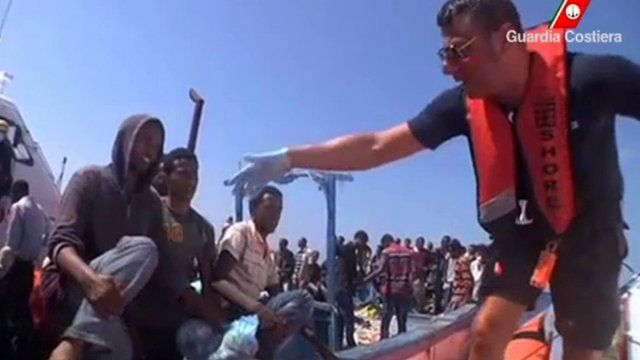 migrants are rescued by Italian Coast Guard officials