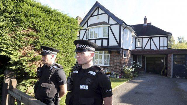 Police guarding the Surrey home of Saad al-Hilli