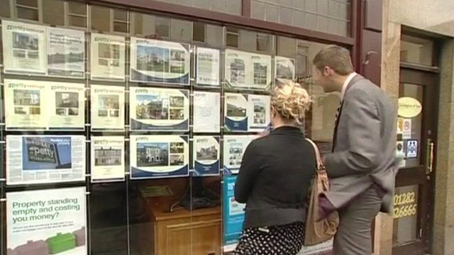 People looking in estate agents