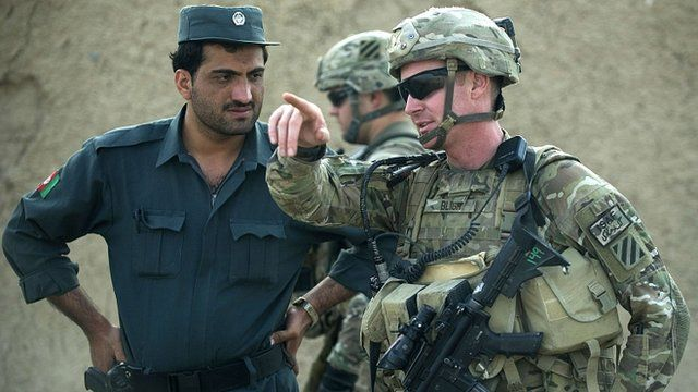 US army lieutenant with a member of the Afghan national police force in Kandahar on 12/09/12