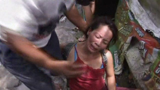 One of the residents of the Taguig settlement being evicted