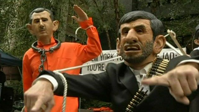 People dressed as Syria's President Assad and Iran's President Ahmedinijad outside the UN
