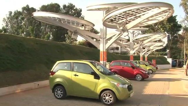 Electric cars being charged by solar power, India