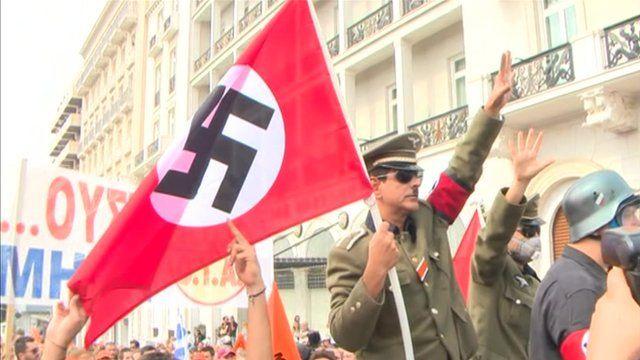 Protesters greeted Angela Merkel