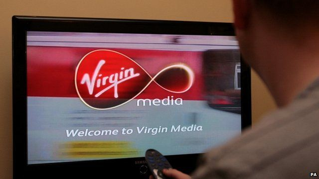 A man looking at a Virgin Media welcome screen