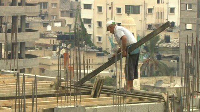 Man works on building site in Gaza
