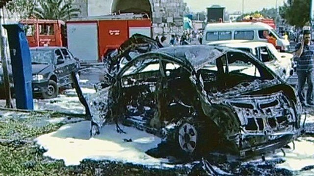 Burnt-out car following explosion in Damascus