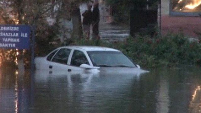 A car in an flooded street in Turkey