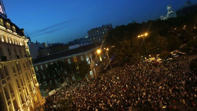 Protesters gather outside Spain's parliament building
