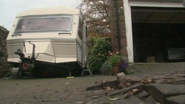 Caravan and flood damaged paving