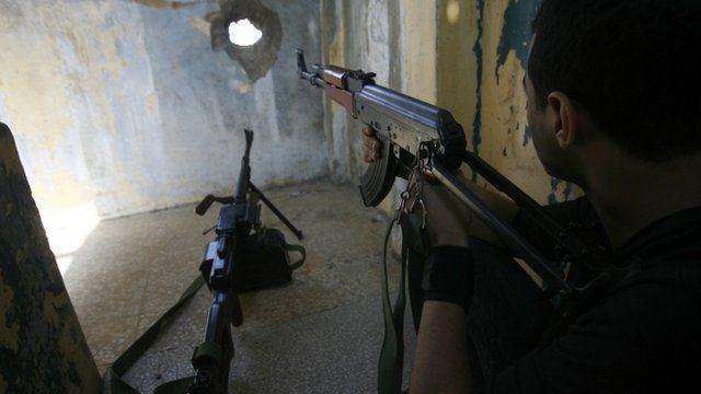 Member of Hezbollah with gun